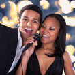 African Couple Singing With Microphone — Stock Photo