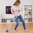 Young Woman Dancing While Cleaning Floor — Stok Fotoğraf #24592443