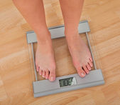 Low Section Of Woman Measuring Weight — Stock Photo
