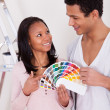 African Couple Choosing Color For New Home — Stock Photo #24963731