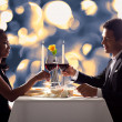 Stock Photo: Romantic Couple Toasting Red Wine