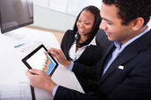 Two Businesspeople Looking At Digital Tablet — Stock Photo
