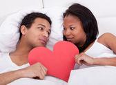 Couple Holding Heart — Stock Photo