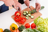 Couple Chopping Vegetables — Stock Photo