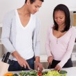 Stock Photo: Couple Chopping Vegetables