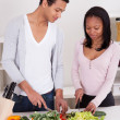 Couple Chopping Vegetables - Stock Photo