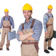 Portrait of happy construction workers - Stock Photo