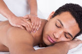 Man Receiving Massage From Female Hand — Stock Photo