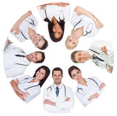 Low angle view of diverse group of doctors — Stock Photo