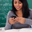 Portrait Of Female Student Using Cell Phone — Stock Photo #25452527