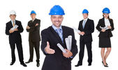Portrait of happy architect and his team — Stock Photo