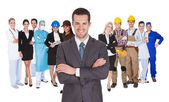 Werknemers van verschillende beroepen samen op wit — Stockfoto