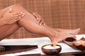 Young Woman Applying Oil Her Legs — Stock Photo