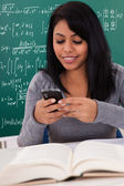 Portrait Of Female Student Using Cell Phone — Stock Photo