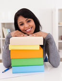 Young Woman Smiling On Stack Of Books — Stock Photo