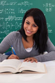 Portrait Of Female Student Studying — Stock Photo