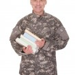 Mature Soldier Holding Stack Of Books — Stock Photo