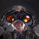 Mature Soldier Looking Through Binoculars — Stock Photo #26408513