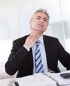 Mature Businessman Feeling Uncomfortable — Stock Photo