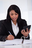 Businesswoman Doing Calculations — Stock Photo