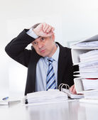 Exhausted Mature Businessman At Work — Stock Photo