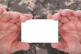 Mature Soldier Holding Blank Paper — Stock Photo