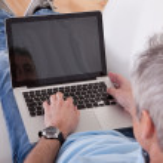 Mature Man Using Laptop — Stock Photo #26667245