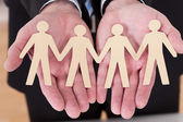 Masculino mão segurando o recorte de figura humana — Foto Stock