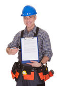 Happy Technician Pointing On Clipboard — Stock Photo