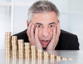 Shocked Businessman With Stack Of Coins — Stock Photo