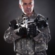 Portrait Of A Mature Soldier Aiming With Gun — Stock Photo