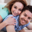 Happy Young Couple Lying On Front — Stock Photo