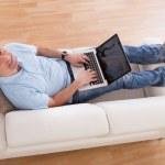 Mature Man Using Laptop — Stock Photo #27055413