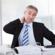 Mature Businessman With Neck Pain — Stock Photo #27055673