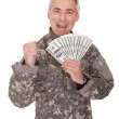 Happy Mature Soldier Holding 100 Dollar Bills — Stock Photo #27055675