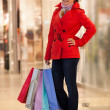 Young woman with shopping bags — ストック写真