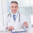 Portrait Of Mature Male Doctor — Stock Photo #27055725