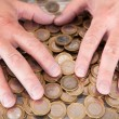 Male Hand On Coins — Stockfoto