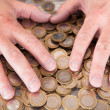 Male Hand On Coins — Foto Stock