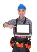 Technician Pointing On Laptop — Stock Photo