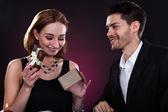 Portrait of happy couple holding gift — Stock Photo