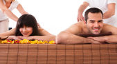 Beautiful Young Couple Enjoying Massage — Stock Photo