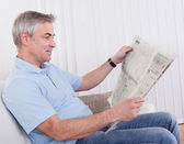Mature Man Reading Newspaper — Stock Photo