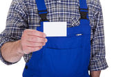 Mature Male Technician Holding Visiting Card — Stock Photo