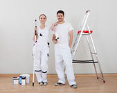 Young Couple Holding Paint Roller — Stock Photo