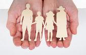 Male Hand Holding Family Cutout Shape — Stock Photo