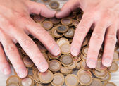 Male Hand On Coins — Stock Photo