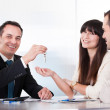 Consultant Giving Keys To Couple — Stock Photo