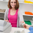 Young Female Cashier With Cash Register — Stock Photo