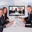 Stock Photo: Group Of Businesspeople In Video Conference